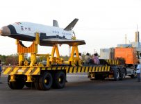 "This handout photograph taken and released by The Indian Space Research organisation (ISRO)on May 23, 2016, shows a scale version of a ""Reusable Launch Vehicle"" or RLV-TD as it is readied for launch from Sriharikota on the south-east coast of India on May 14, 2016.   India successfully launched on May 23, 2016, its first mini space shuttle as New Delhi's famously frugal space agency joined the global race to make rockets as reusable as airplanes. The shuttle was reportedly developed on a budget of just one billion rupees ($14 million), a fraction of the billions of dollars spent by other nations' space programmes.  RESTRICTED TO EDITORIAL USE - MANDATORY CREDIT ""AFP PHOTO/ISRO"" - NO MARKETING NO ADVERTISING CAMPAIGNS - DISTRIBUTED AS A SERVICE TO CLIENTS  / AFP PHOTO / ISRO AND AFP PHOTO / HO / RESTRICTED TO EDITORIAL USE - MANDATORY CREDIT ""AFP PHOTO / ISRO"" - NO MARKETING NO ADVERTISING CAMPAIGNS - DISTRIBUTED AS A SERVICE TO CLIENTS"
